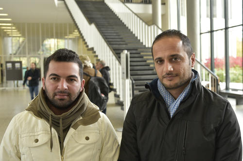 "Ibrahim (left) and Amin in the Henry Ford Building at Freie Universität Berlin. ""A normal life"" is the fondest hope for Amin, 30."