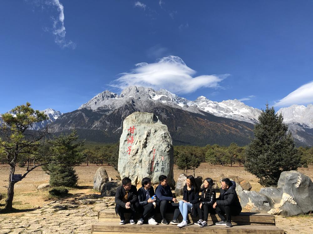 Vivi Feng with a group of friends in front of the Jade Dragon Snow Mountains in Lijiang.