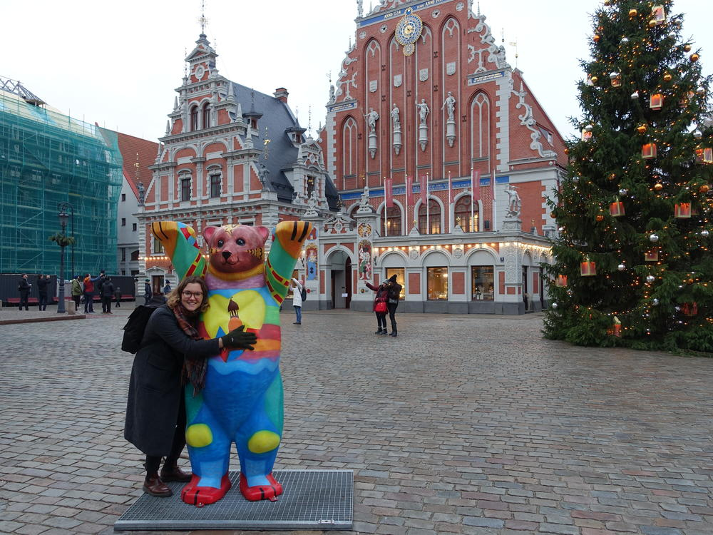 "On the Town Hall Square in Riga, a Berlin Buddy Bear commemorates the exhibition of 149 ""United Buddy Bears"" on display in 2018 in honor of the centennial anniversary of the founding of the Latvian state."