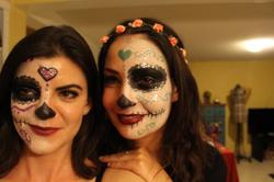 Wearing traditional makeup for Día de los Muertos: Estefanía González (left) and her friend Laura Zunker.