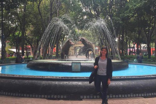 Estefanía González in front of the famous Fuente de los Coyotes in the district of Coyoacán, where the Mexican painter Frida Kahlo lived.