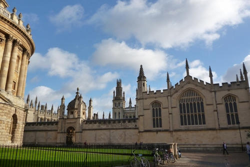 Magnificent old buildings dominate the skyline: All Souls College next to the Radcliffe Camera.