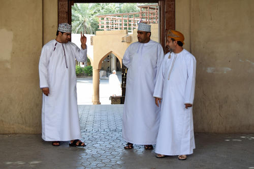 Menswear in Oman: The ankle-length tunic is called a 'dishdasha'; the headdress is known as 'kuma' or 'massar.'