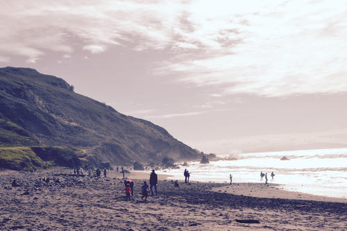 Muir Beach, north of San Francisco Bay. Even in January there are some hardy Californian surfers going into the water.