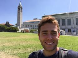 Selfie in front of the Sather Tower, the landmark of the University of California, Berkeley. The university library is at the right.