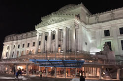 The neoclassical building, where the collections of the Brooklyn Museum are housed, as seen at night.