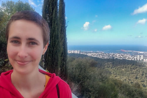 Chanah Kempin in front of the wonderful view of the city and the Mediterranean Sea from the University of Haifa.