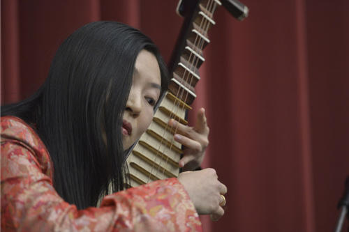 Music from Japan, South Korea, and China accompanied the ceremony. Here Jingyu Zhang is shown playing the pipa, a traditional Chinese lute.
