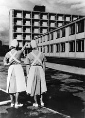 Two nurses admiring the newly completed nurses' quarters on the campus of the new university hospital complex in Steglitz. The nurses' quarters were funded by the Benjamin Franklin Foundation and were dedicated on July 4, 1962.