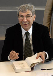2007 – After the ceremony awarding Orhan Pamuk an honorary doctorate, he autographs copies of his books for members of the audience.