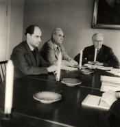 1949 – Academic senate meeting.  Seated, right to left: Prof. Dr. Edwin Redslob, Prof. Dr. Schäfer, and student Hartwich. During the blockade, candlelight often replaced electricity.