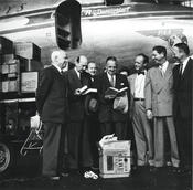 Paul G. Hoffmann, President of the Ford Foundation, handing over the first delivery of the 20,000 books that the American Brotherhood was to collect for Freie Univ. to Freiherr von Kreß, President of Freie Universität, at Tempelhof Airport.