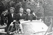 This was the moment the crowd in Dahlem had been waiting for: John F. Kennedy arrives, standing in an open limousine with the Governing Mayor of Berlin, Willy Brandt, and Chancellor Konrad Adenauer.