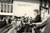 John F. Kennedy is received enthusiastically by the audience in Dahlem.