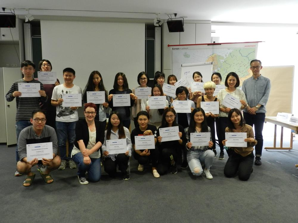Group picture with certificates.