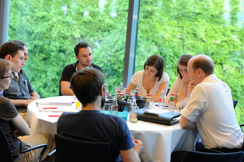Junior faculty members met for discussions at the Round Table Forum on June 20, 2013.